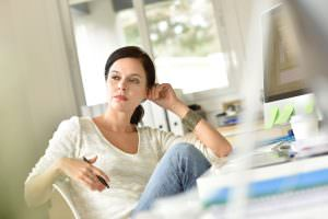 woman sitting in chair thinking about love after divorce