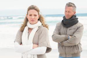 upset couple on the beach