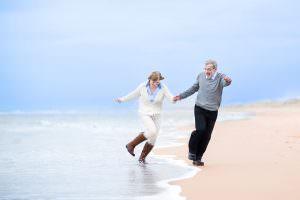 happy mid life couple on beach