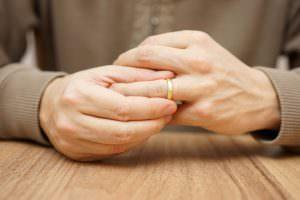 man holding wedding ring finger