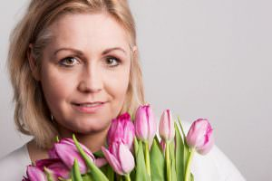 middle aged woman holding tulips
